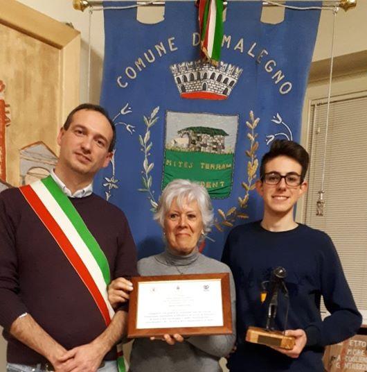 Paolo Erba, Elisabetta Panteghini, promotrice della candidatura, ed il nipote di don Lino Zani